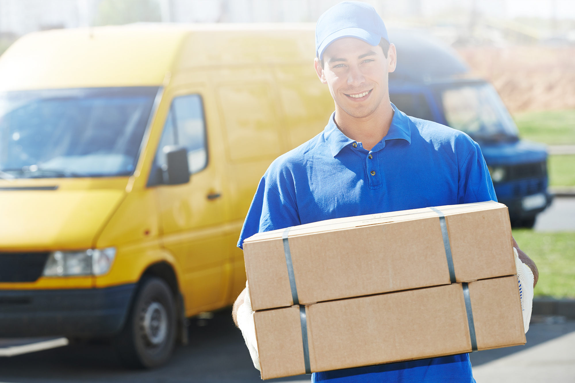 Parcel Delivery Man Holding Shipping Packages