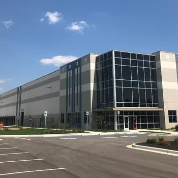 Exterior shot of on of IDS Fulfillment's warehousing and distribution facilities with blue skies in the background.